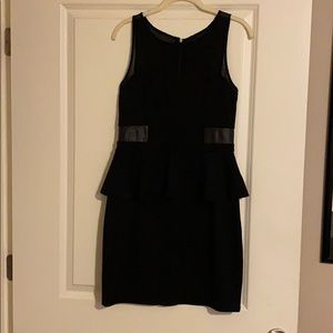 Black peplum zip dress with leather detail
